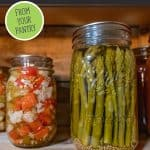 "Up close image of canned asparagus and canned veggies with text overlay, ""Feed Your Family All Year"""