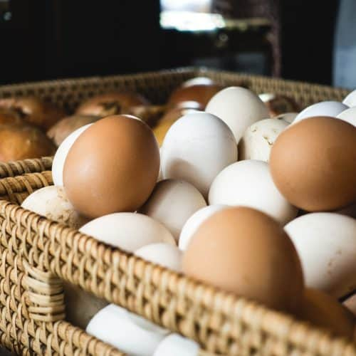 Dozens of eggs in a basket.