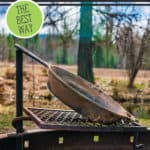 "Image of a rusty cast iron pan on a fire pit grate. Text overlay says, ""How to Strip and Re-Season Cast Iron""."