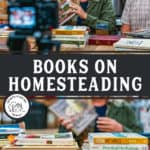 "Pinterest pin with a man and a woman sitting behind a table filled with books. Text overlay says, ""Books on Homesteading""."