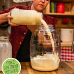 """Pinterest pin with an image of a woman pouring cream into an electric butter churn. Text overlay says, """"Homemade Butter Recipe""""."""
