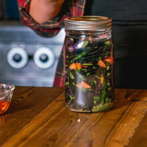 A mason jar of fermented green beans.