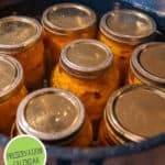 Photo of jars in a canner. Pinterest pin of what to preserve each month of the year.