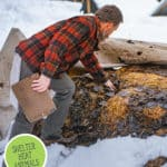 Pinterest pin with an image of a man checking on a snow covered compost pile.