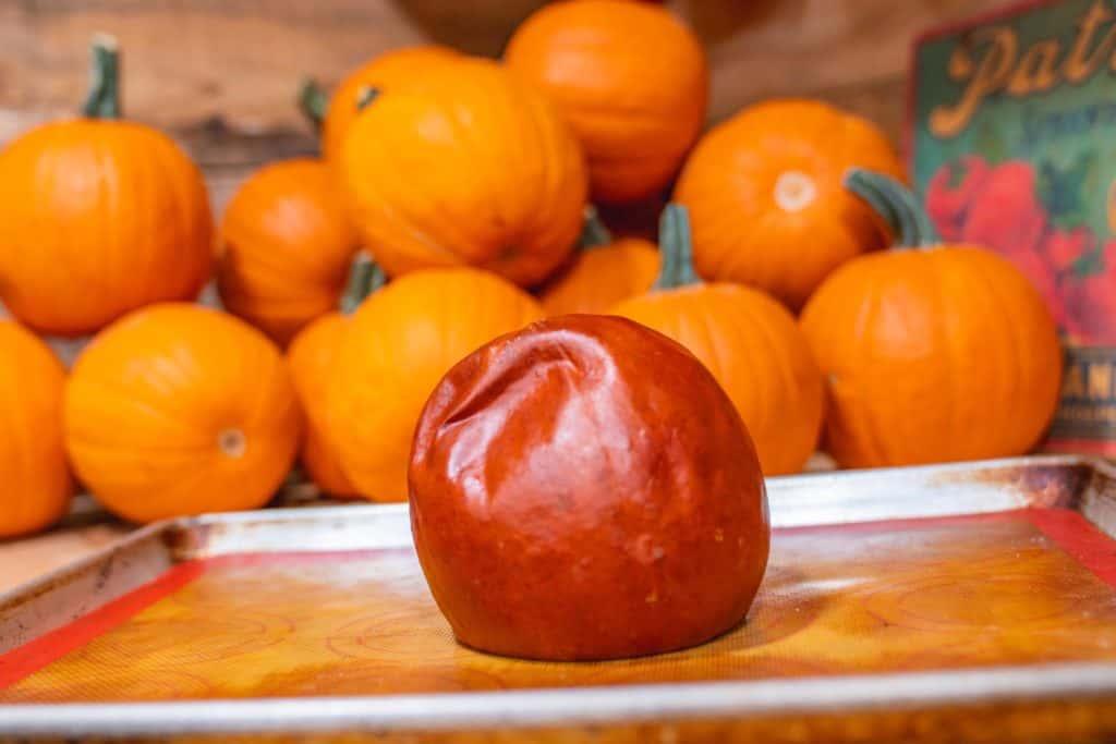 A roasted pie pumpkin on a baking sheet.