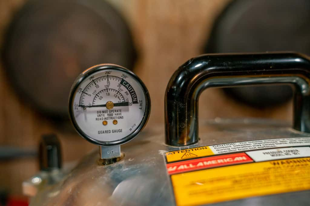 The gauge of a pressure canner at zero.