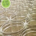 Pinterest pin with an image of a bunch of empty canning jars.