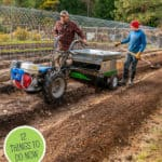 Pinterest pin with an image of two people spreading compost on the garden using a BCS tractor.
