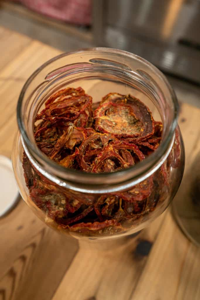 A large jar of dehydrated tomatoes.