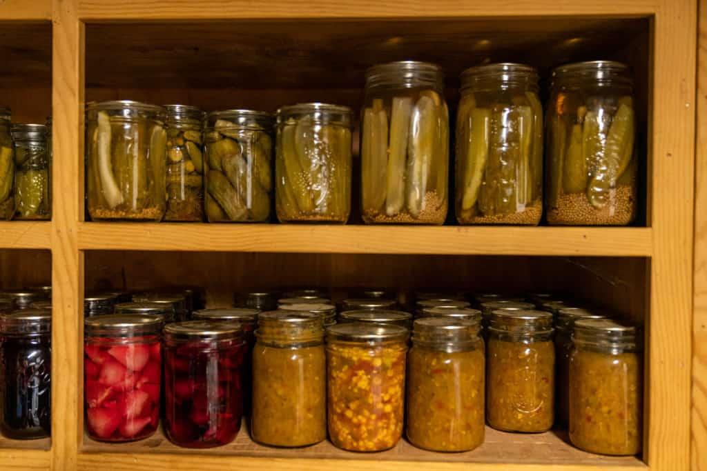 Home canned veggies on a shelf.