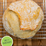 """Pinterest pin with an image of an artisanal loaf of bread on a cooling rack. Text overlay says, """"5 minute no knead artisan bread""""."""