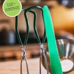 Pinterest pin for how to can broth with an image of canning tools.