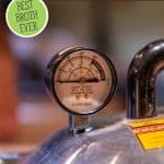 Pinterest pin for broth making tips with an image of a pressure canner filled with jars of broth.