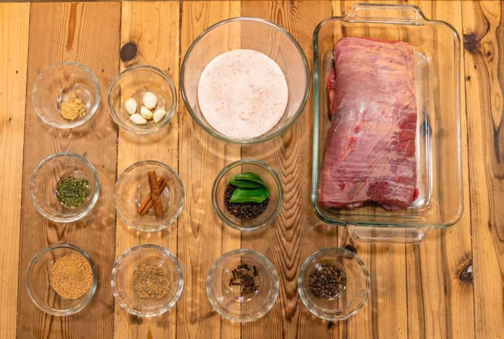 Herbs, spices, seasonings, and a beef brisket. All the ingredients needed to make corned beef.