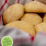 Pinterest pin for five recipes to make with the no-knead five minute bread dough. Images of baked garlic and parmesan rolls in a basket lined with a red and white towel.