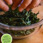Pinterest pin for a comfrey compress remedy with an image of a glass bowl with dried comfrey leaves.