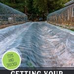 Pinterest pin for early spring garden tips with an image of a garden bed covered in row plastic.