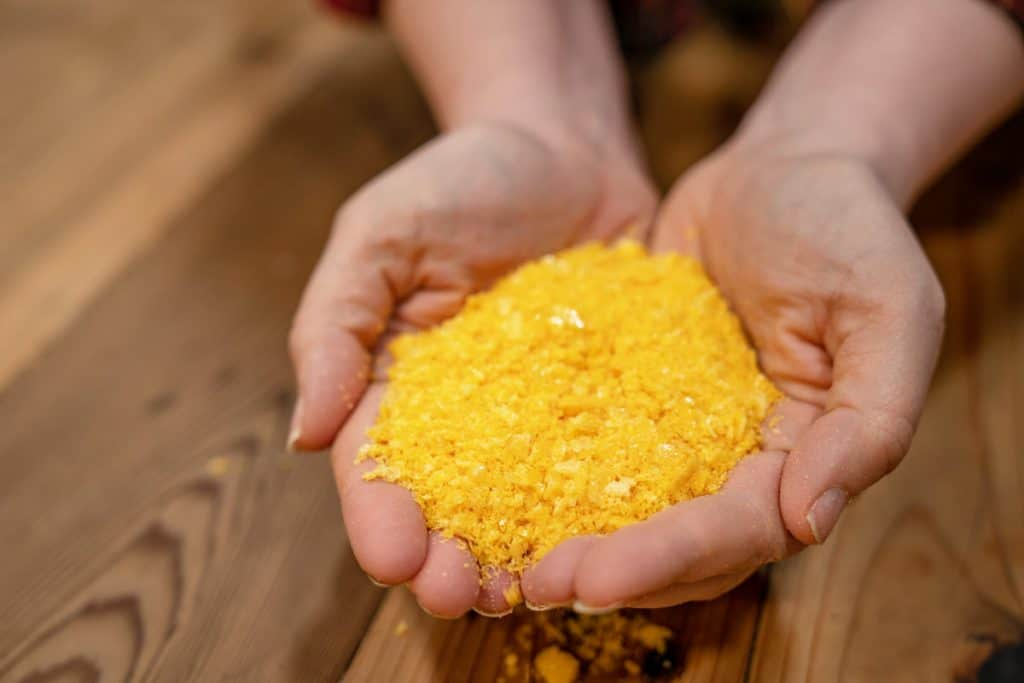 A woman's hands holding freeze dried eggs.