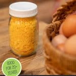 Pinterest pin for freeze dried eggs. Images of fresh eggs and freeze dried eggs in a jar.