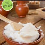 Pinterest pin for rendering lard with an image of creamy white lard in a bowl with a wooden spoon.