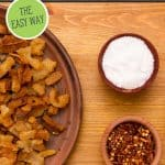 Pinterest pin for rendering lard with an image of cracklings in a bowl next to salt and red pepper flakes.