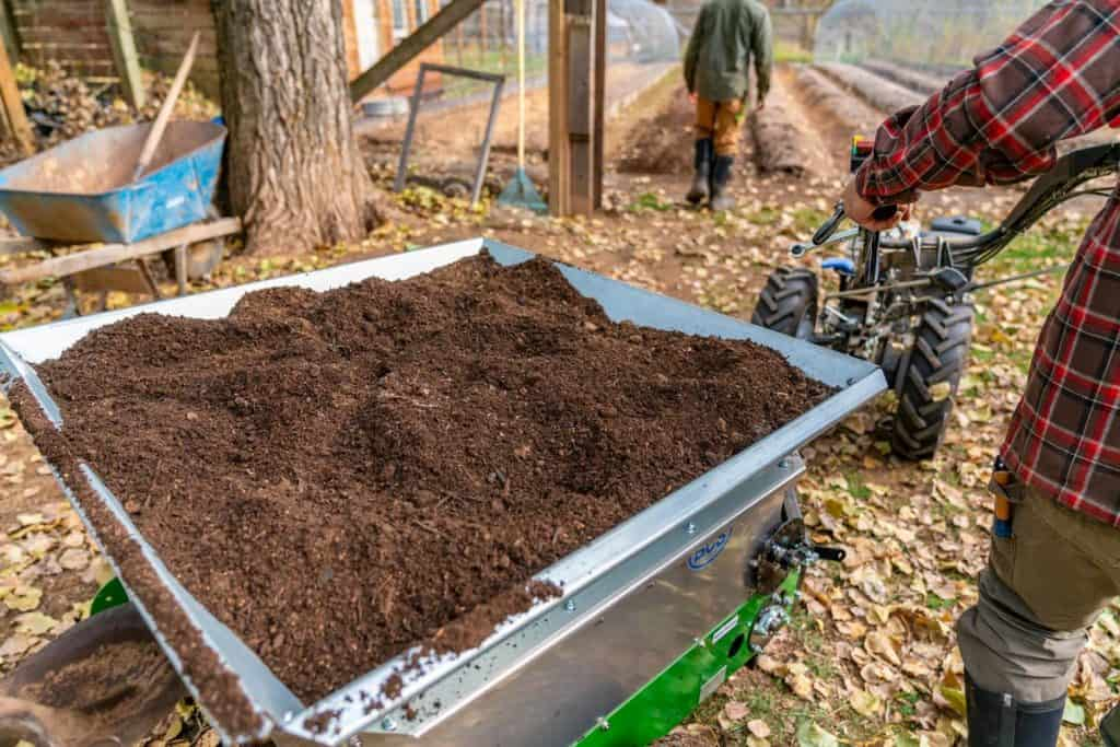 A BCS tractor filled with sifted soil and compost.