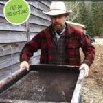 Pinterest pin for a DIY Compost Sifter or soil sifter. An image of a man sifting compost using the sifter.
