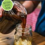 Pinterest pin for homemade switchel (or haymaker's punch) with an image of a glass of iced switchel in a mason jar.