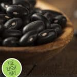Pinterest pin for how to can black beans with images of cooked and uncooked black beans.