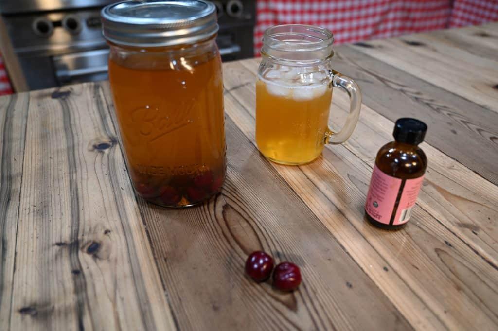 Ingredients for homemade cherry almond kombucha.