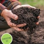 Pinterest pin for how to make compost the easy way at home. Image of hands holding a scoop of finished compost.