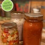 Pinterest pin for prepping and cleaning out your pantry for the upcoming preserving year. Image of canned food in mason jars.