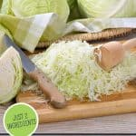Pinterest pin for homemade sauerkraut. Image of sliced cabbage on a cutting board.
