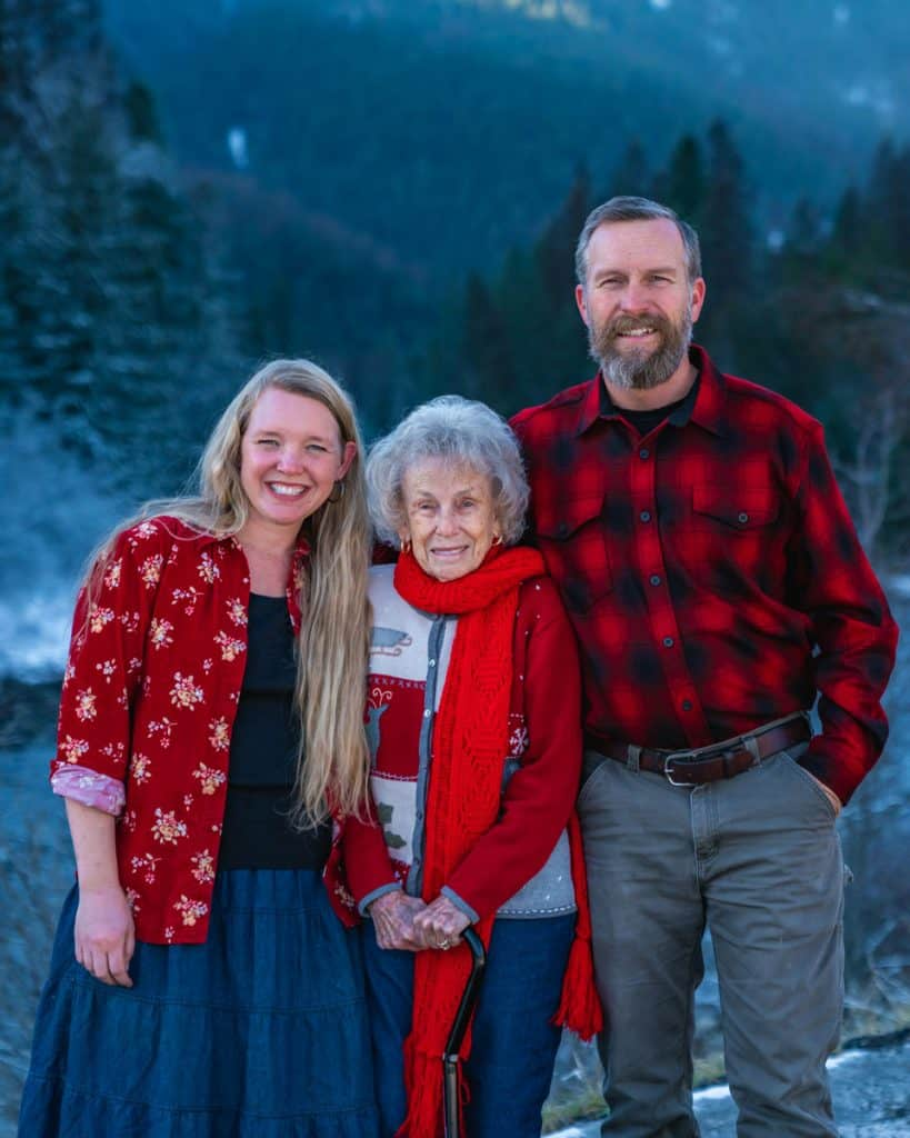 Image of three people posing for a Christmas photo.